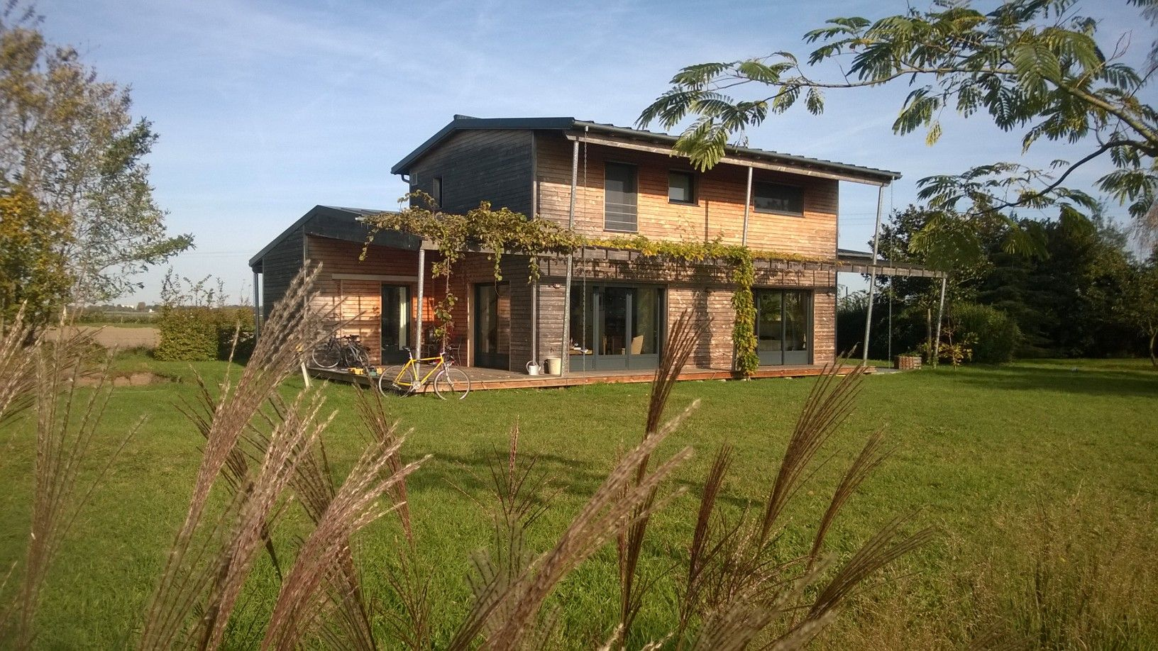 Maison individuelle a ossature bois et son agrandissement for Agrandissement maison individuelle